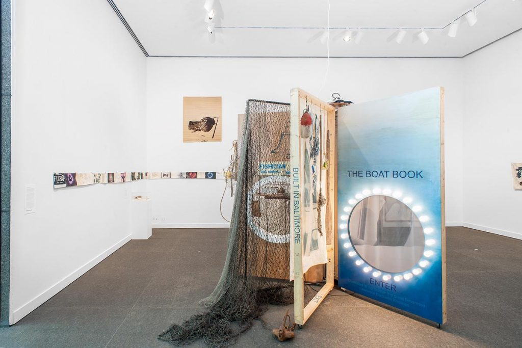 Alison Knowles, The Boat Book, 2014-15 Wood and metal frame with silkscreen, digital print on silk, collage, assemblage, personal ephemera, beans, books, fishing net, photographs, ship anchor, fabric tunnel, electrical lights, audio recording, etc., Courtesy the artist and James Fuentes Gallery, New York Photo: Bryan Conley, Carnegie Museum of Art