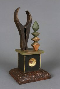 Phillip Shore_When I was a Tree, 2018, wood, acorn, root, seed, resin, metal leaf, paint, 16x8x7_